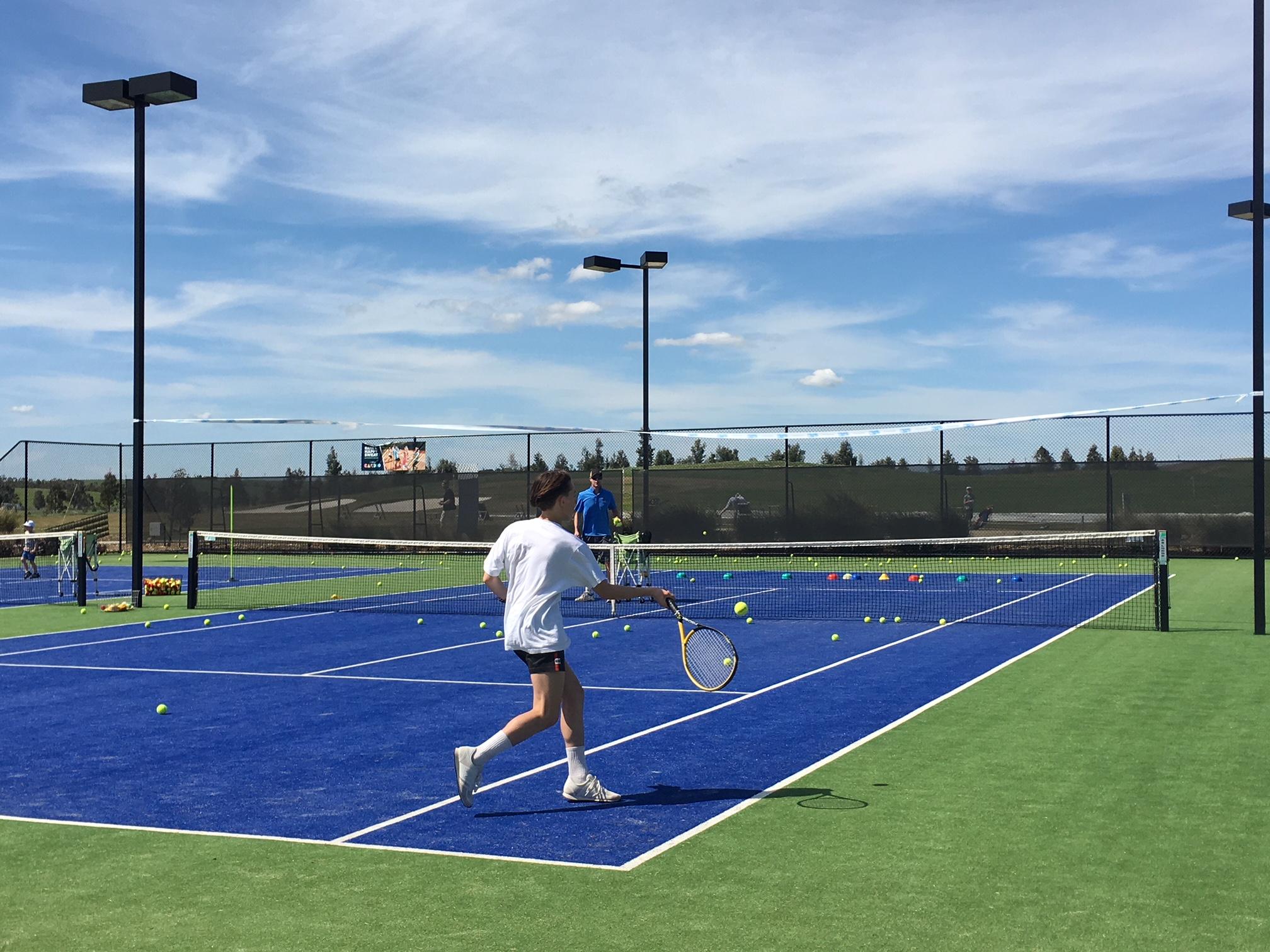 Playing tennis at Eastern Golf Club